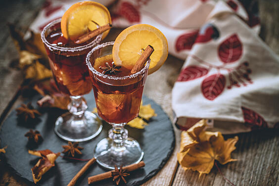 Autumn Mulled wine with juicy orange and spices; An Autumn cocktail