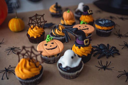 Halloween decorated cupcakes featuring spider webs and ghosts and witches.