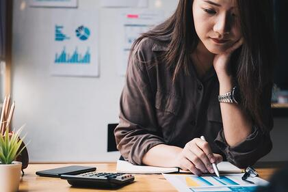 A young woman works on her accounting business.