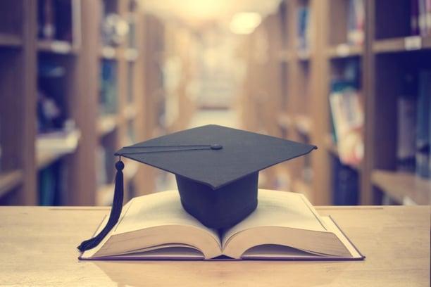 book on top of grad cap