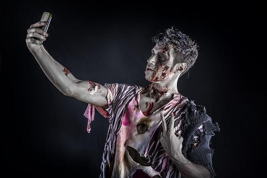 A zombie college student takes a selfie.