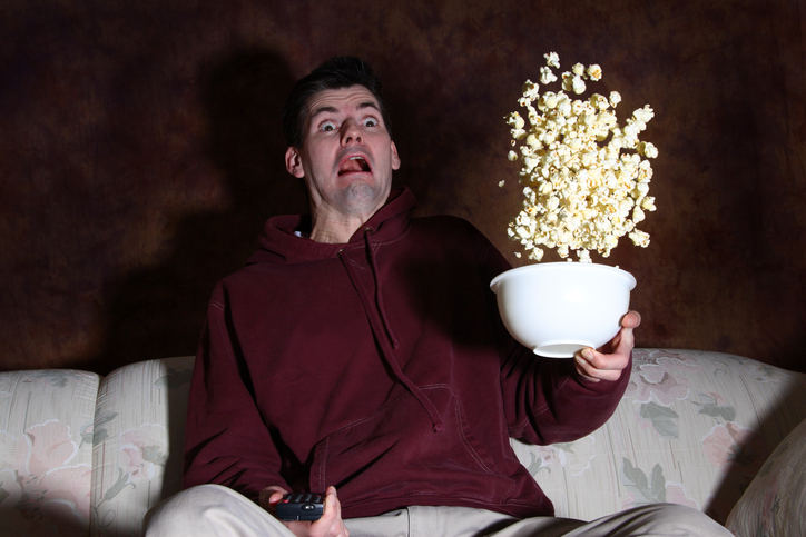 Man loses his popcorn because he gets startled with fright...eeek!