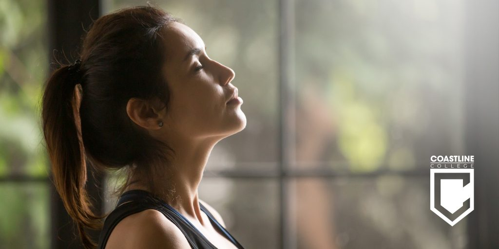 A woman practicing deep breathing. Title Image.